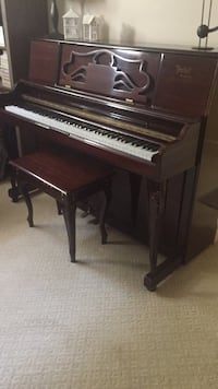 Brown wooden upright piano with chair North Vancouver, V7R 3W8