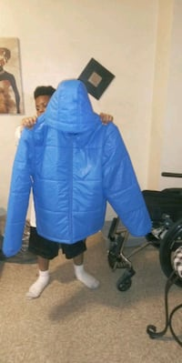 Warrington Blue quilted coat.  Never worm  price tag still