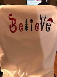 white textile with Believe print