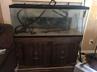 55 gal saltwater tank. comes with two canister filters, stand, tank and sand. Fort Mitchell, 36856