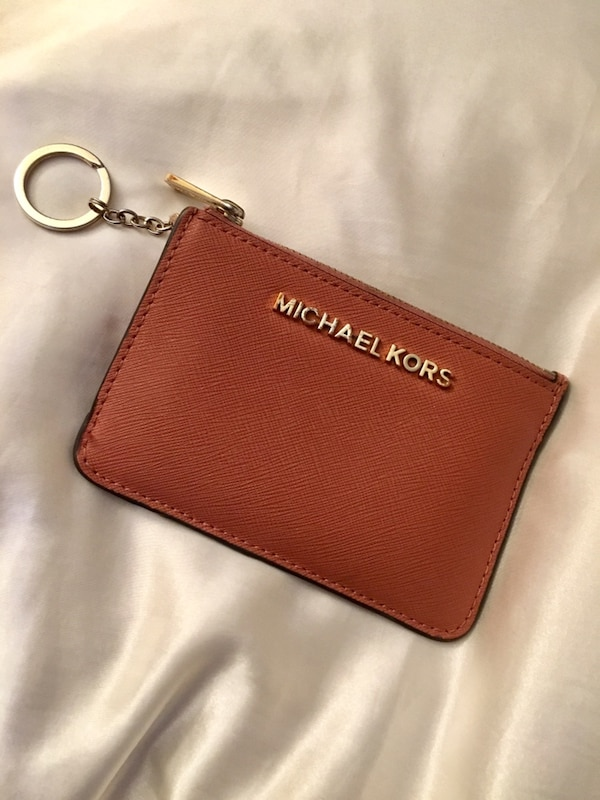 1000% authentic Michael kors wallet on keychain