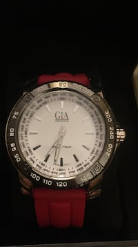 Round silver analog watch with red silicon strap Mississauga, L5M 8B9