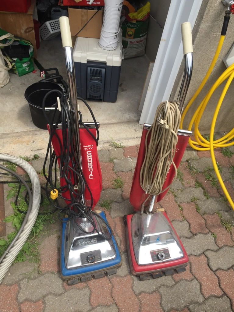 two red upright vacuum cleaners for sale  Laval