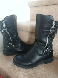 pair of black leather boots Calgary, T2Y 4S7