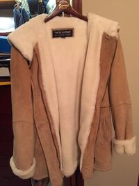 white and brown Wilsons leather jacket and mittens