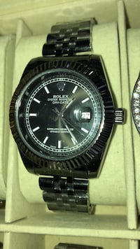 round black Rolex analog watch with silver link bracelet Brampton, L6T