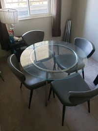 Glass dining table +4 chairs