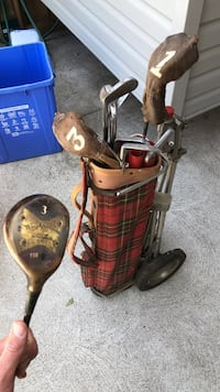 Red and black golf bag with golf clubs Windsor, N8W 2R4