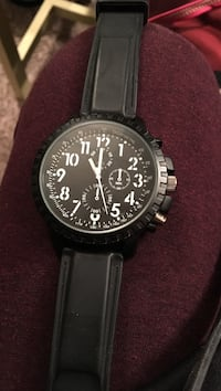 round black chronograph watch with black leather strap Spruce Grove, T7X 2E3