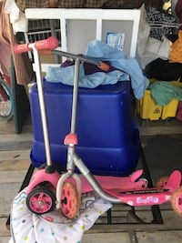 two pink kick scooters