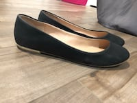 pair of black leather flats Calgary, T2V 3Y3