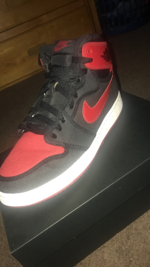 eb63011d7de5 Used unpaired black and red Nike high-top sneaker for sale - letgo