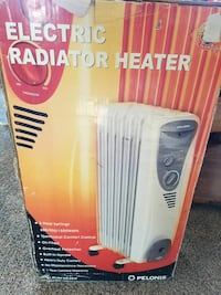 white Pelonis electric radiator heater box