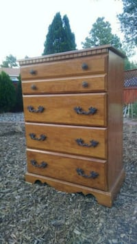 brown wooden 5-drawer tallboy dresser Colorado Springs, 80916