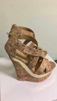Pair of brown leather peep toe wedge. Brand new! Size 6.5 US Lorton, 22079