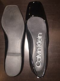 pair of black leather flats Winnipeg, R3C 1Z9