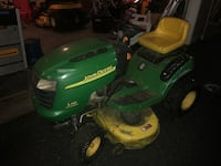 Green and yellow john deere ride on lawn mower Charles Town, 25414