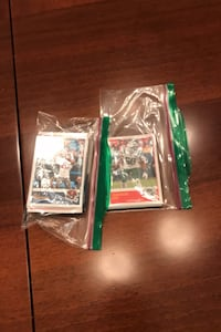 Two ziploc bags full of football cards