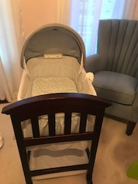 brown wooden framed gray padded armchair 559 km