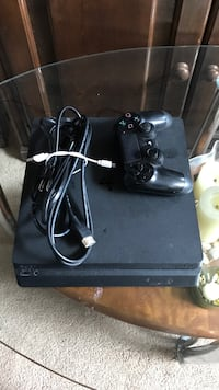 Black sony ps4 with wireless game controller Los Angeles, 90037