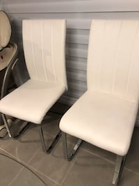 4 leatherette white chairs . Small damage Dollard-des-Ormeaux, H9B 1B6