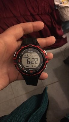 round red and black digital watch