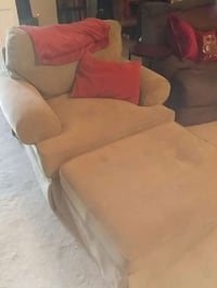 Plush sage green chair and ottoman Waldorf