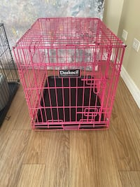 Small pink dog crate with cover
