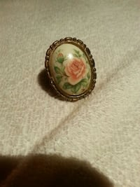 gold-colored ring with white, pink, and green floral gemstone Toronto, M4W