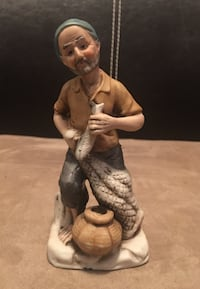 Vintage 6 1/4 Inch High Porcelain Fisherman Figure Holding Fish Net Basket Las Vegas