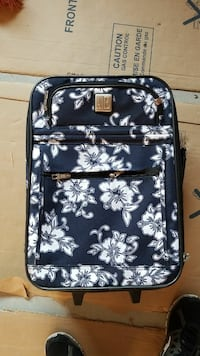 gray and white floral travel luggage Syracuse, 84075