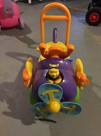 purple, yellow, green, and teal Winnie the Pooh plane ride-on toy Saint Peters, 63376