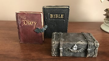 Gray suit case,red diary and black Bible Decor