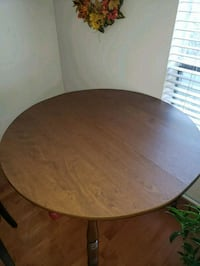 round brown wooden table with two chairs Gaithersburg, 20879