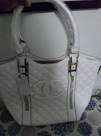 quilted white Chanel leather tote bag