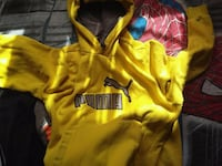 yellow and black Nike pullover hoodie Laval, H7P 3N6