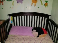 baby's brown wooden crib Miami, 33173