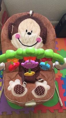 Baby's brown and beige bouncer