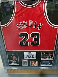 red and black Chicago Bulls Michael Jordan basketball jersey