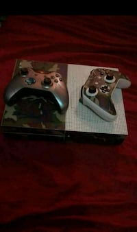 Xbox 1x with 2 controllers and 4 games.