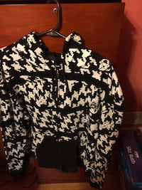 Black and white houndstooth print full-zip hoodie.