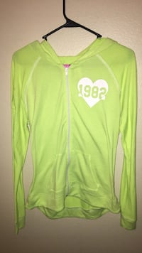 green and white Adidas zip-up jacket