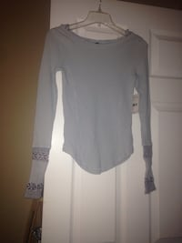 Nwt free people thermal with detailed sleeves.