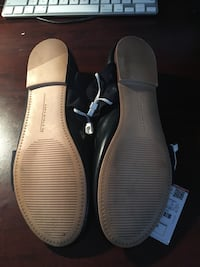 pair of black-and-white sandals Dorval, H4Y