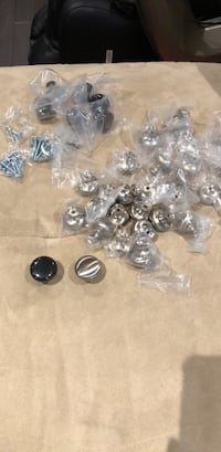 Kitchen cabinet knobs. Slightly used. 26 silvers and 6 blacks Vaughan