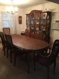 oval brown wooden table with six chairs dining set