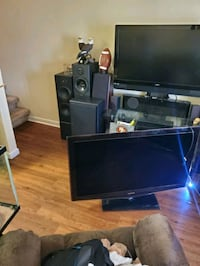 Entertainment center two TVs stereo system