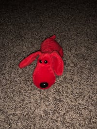 Red and yellow animal plush toy