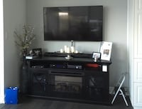 Black wood tv stand with built in electric fireplace Los Angeles, 91406