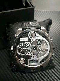 round silver-colored chronograph watch with black leather strap Montréal, H3C 3Z7